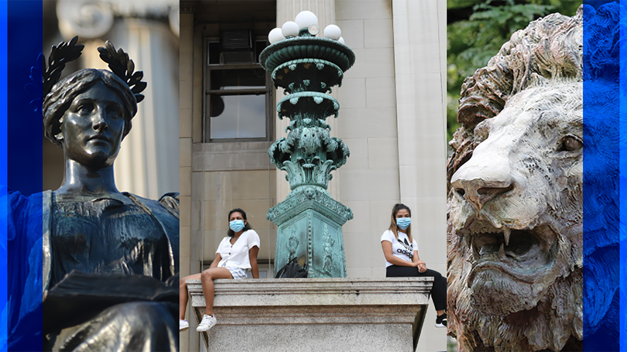 Two masked students wearing short sleeves sit on the steps of Low Library.